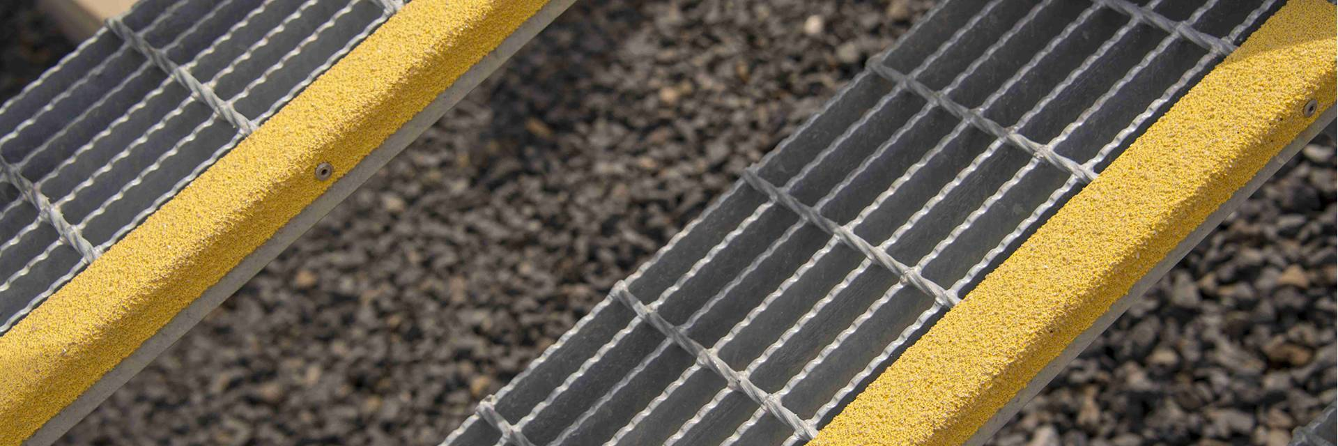 Serrated grid grating with anti-slip nosing are installed as stair treads.