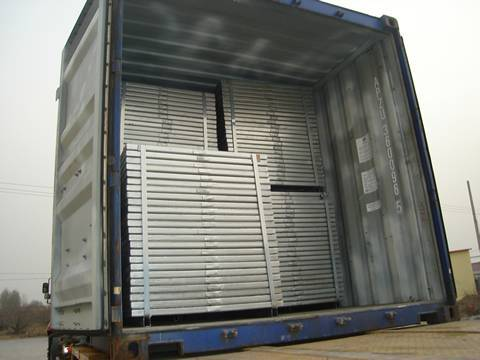 Metal steel grating panels loaded on truck with steel pallet and steel strip package.
