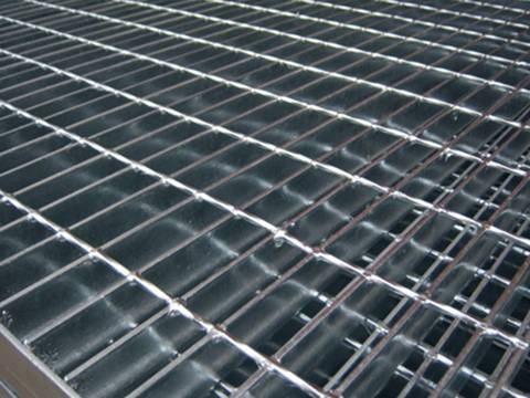 Welded steel bar grating panels with smooth surface on the ground.